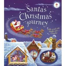 «К нам едет Дед Мороз. Игрушка с заводом, дорожки. Серия Wind-up» книга-панорама на английском Фионы Уотт
